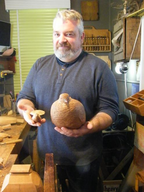Ranfurly wood sculptor Luke Anthony showcases his handiwork including sculptures of a fantail and kereru. PHOTO: ADAM BURNS