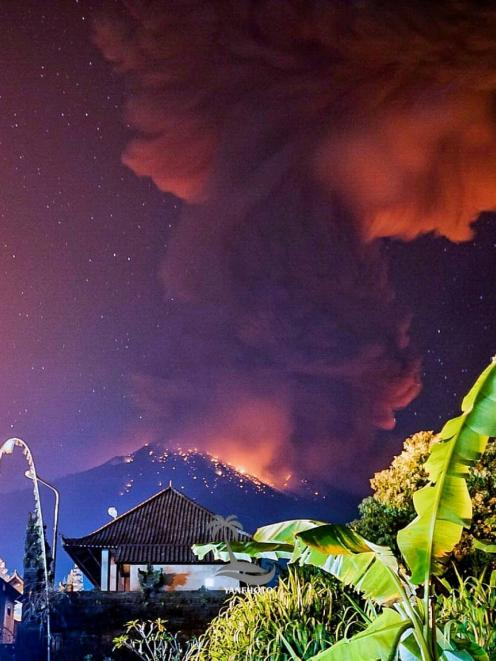 NO ARCHIVEThick smoke and glow from lava are seen as Mount Agung volcano erupts in Karangasem Regency, Bali. Photo: Wayan Kartika via Reuters