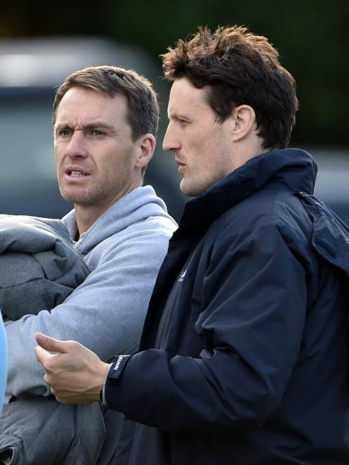 Ben Smith (left) and Glenn Dickson watch the first XV match between King's High School and Otago...