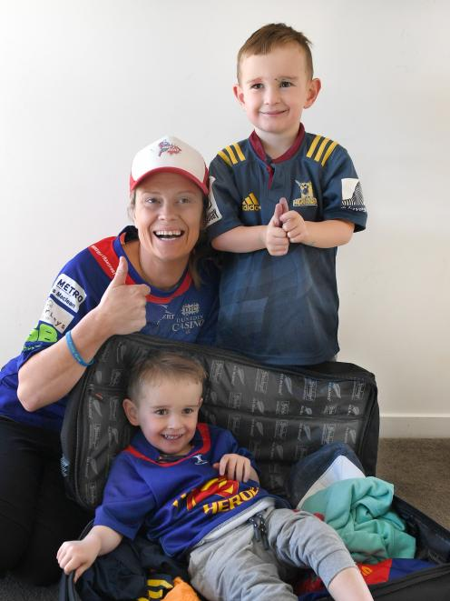 Bex Finch and twin sons Harry (front) and Ollie pack bags, ready for their trip to St Louis Children's Hospital in the United States, where Harry will receive life-changing surgery next Tuesday. Photo: Stephen Jaquiery