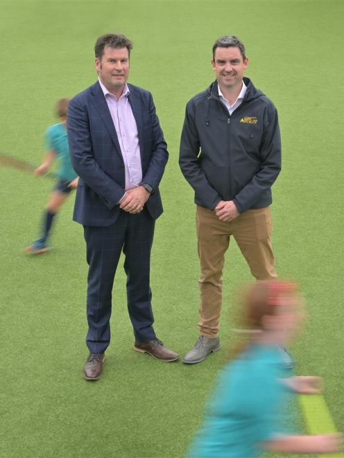 David Booth (left), from King's High School, and Andy McLean, from Otago Hockey, look to make more playing capacity at the Logan Park Hockey Turf yesterday. Photo: Christine O'Connor