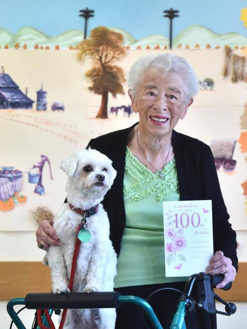Muriel Barbara and her dog Mella get ready to celebrate her 100th birthday. Photo: Peter McIntosh