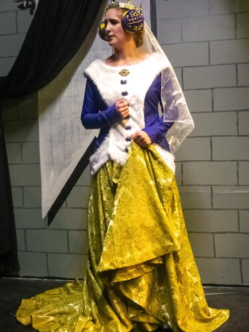 The Queen, played by Beth Lochhead, in her costume of found fabrics.