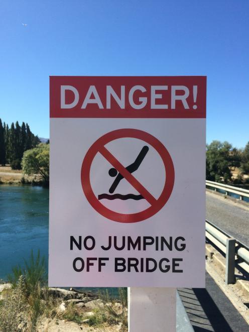 The Albert Town bridge's no jumping sign. Photo: Liz Breslin