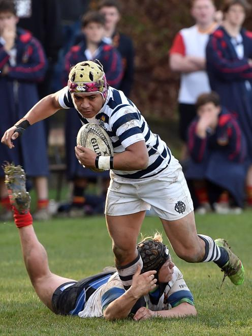 Otago Boys High School first five-eighth Tevita Asi is tackled by John McGlashan College hooker...