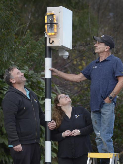 BFW Innovations business partners Grant Woolford (left) and Vicky Steel, with Larry Burns and the crossing sensor he has invented. Photo: Gerard O'Brien