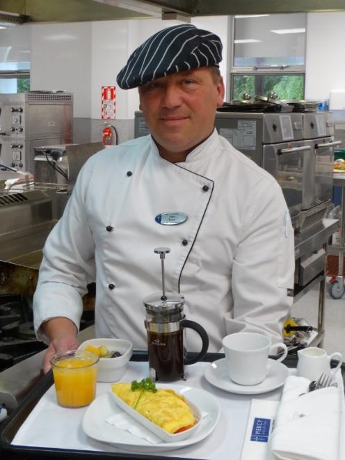 Mercy Hospital head chef-food service team leader Uwe Braun has prepared a typical omelette breakfast tray served to patients from an a la carte menu.  Photo: Brenda Harwood