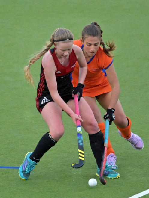 Momona striker Nicole Strawbridge (left) and City Highlanders defender Sara Cooper compete for...