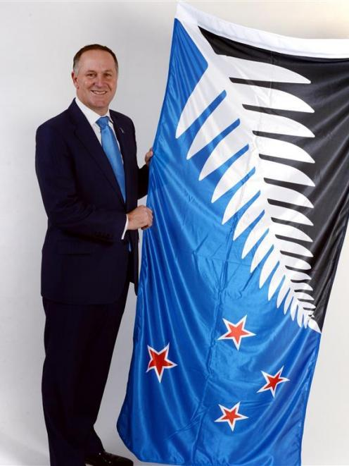 Then-Prime Minister John Key with the Kyle Lockwood design that lost in a referendum to change...