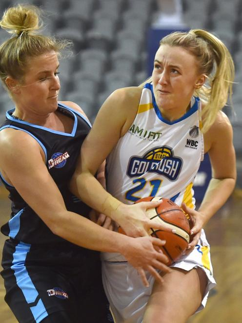 Otago Gold Rush guard Nicole Ruske takes the ball to the hoop as Auckland Dream guard Casyn...