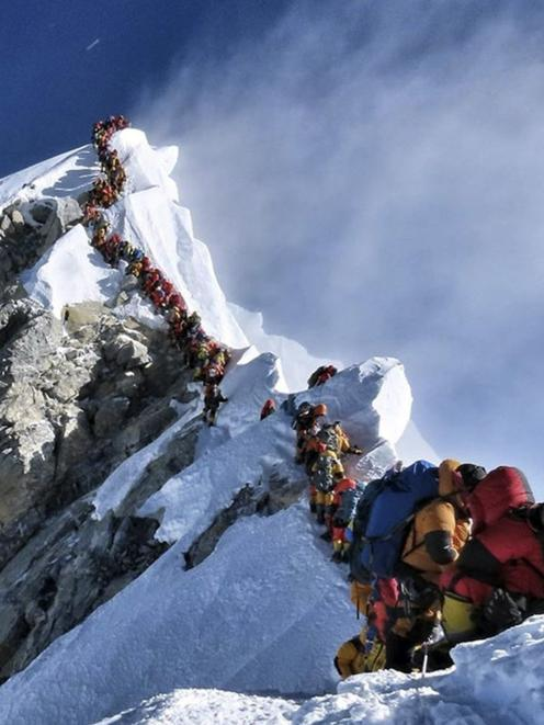 The photo of climbers on Everest that said it all from May 22, taken and released by climber...