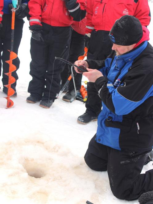 Marrku shows ice-fishing novices how it's done.