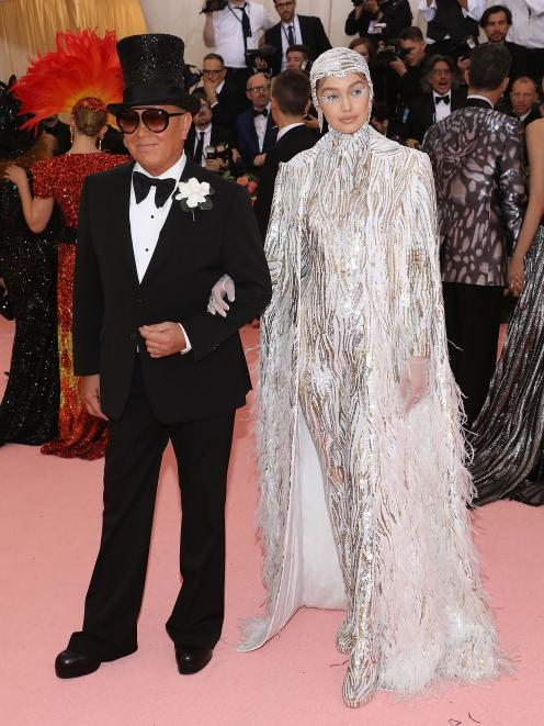 Designer Michael Kors and Gigi Hadid attend the Metropolitan Museum of Art's Costume Institute...
