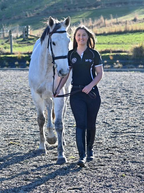 Outram rider Hollie Kooman gets in some training with her horse Silver Gamble in Outram yesterday. Kooman will represent New Zealand at the Nation's Cup in Hong Kong next month. Photo: Linda Robertson