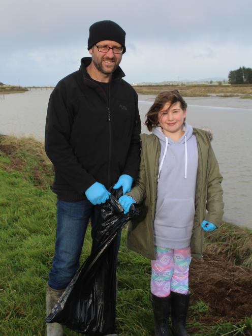 Invercargill locals David and Lucy Hart did their bit to clean up the river banks.
