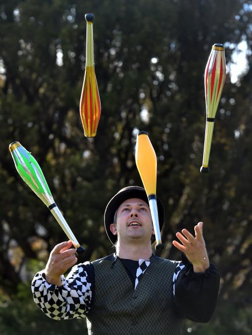 Miguel Nitis performs on World Juggling Day on Saturday. PHOTO: PETER MCINTOSH