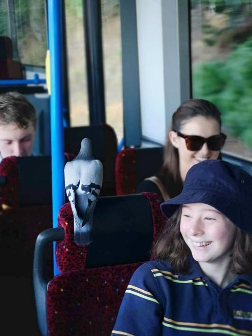 Mo on the bus with Tahuna Normal Intermediate School pupil Hannah Hogan (12). Photo: Paul Pope