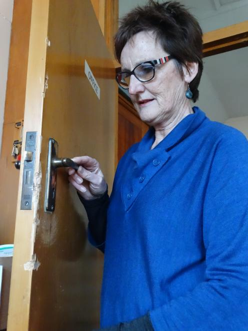 The Rev Rose Luxford inspects damage to a door at St Paul's Church in Coquet St in Oamaru. The...