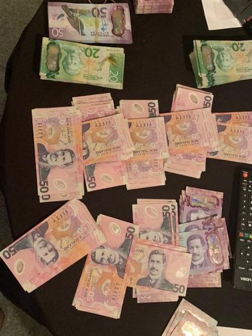 Police seized more than $30,000 in cash after raids in Queenstown and Cromwell yesterday. Photo:...