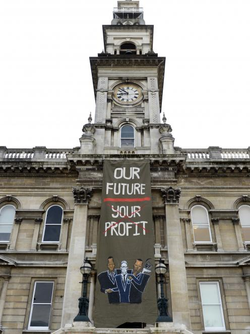 A large anti-mining banner was unfurled down the front of the Municipal Chambers. Photo: Gerrard...