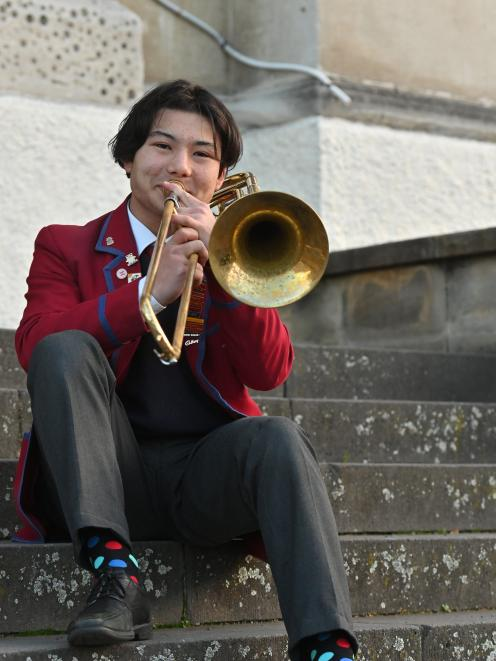 Sebastian Hook plays the trombone he will be using in the National Secondary Schools' Brass Band....