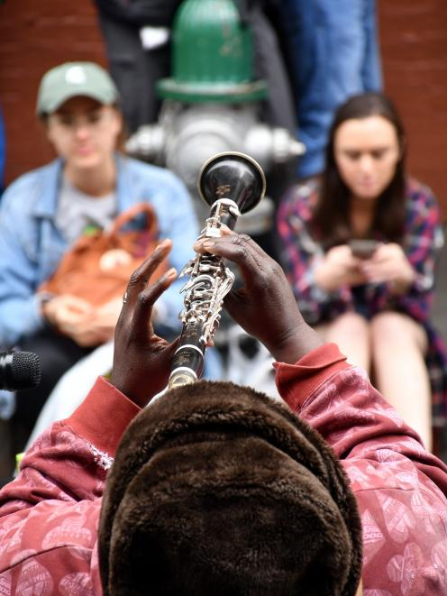Doreen Ketchens, on clarinet, and her band play Royal St, New Orleans.