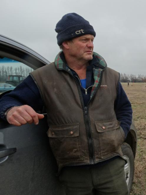 Ploughing competition organiser John Osborne watches the field.