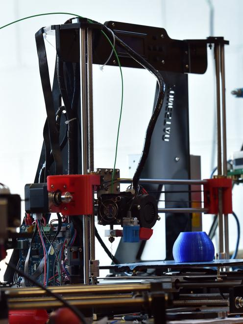A 3-D printer in the Makerspace.