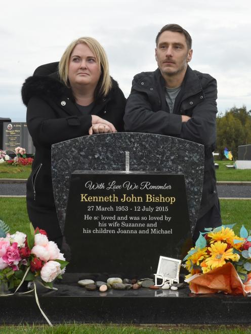 Joanna and Philip Bishop-Cherry want thieves to return a sculpture to the top of the gravestone...