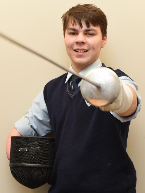 King's High School's Corey Symon (17) takes a break from school before leaving for the Australian under-17 national fencing championships last week. Photo: Gregor Richardson