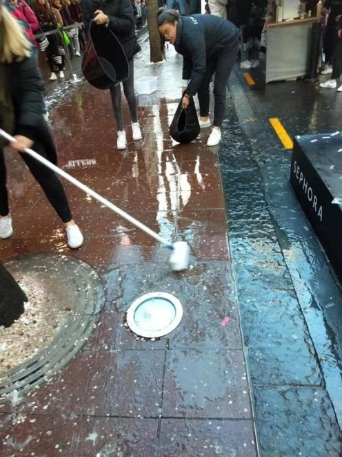 Sephora staff cleaning the area after the store's opening. Photo: Matthew Tukaki via RNZ