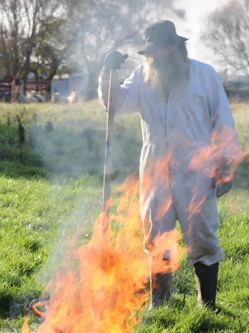 Southland commercial beekeeper Geoff Scott demonstrates what to do with an American foulbrood-infected hive - burn it.