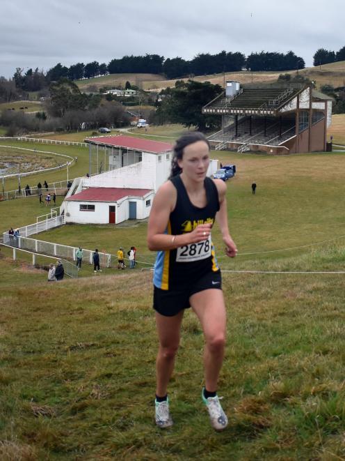Senior women's winner Rebekah Greene calls on all her reserves on the steep climb at the top of...