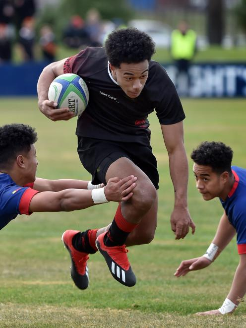 Waitaki Boys' High School second five-eighth Semisi Kaufusi powers past St Kevin's College rivals...