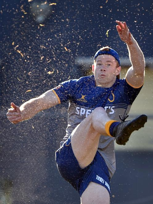 Otago rookie first five-eighth Ben Miller boots the ball during a training session at Logan Park...