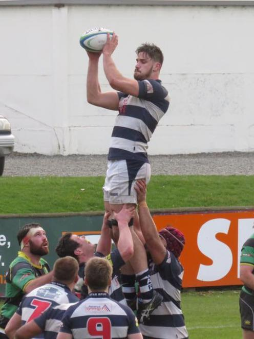 Star lineout jumper Maanaki Selby-Rickett takes a lineout throw during his team's 34-20 upset win...