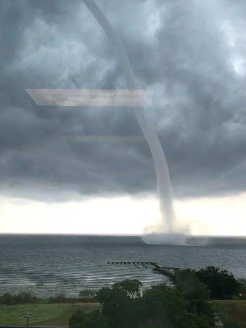 (NO ARCHIVE)A waterspout is seen on Lake Pontchartrain off New Orleans, Louisiana. Photo: Bryon Callahan via Reuters