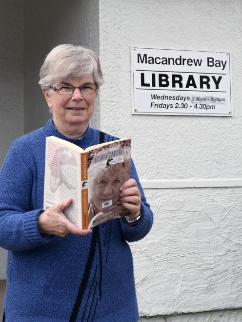 Macandrew Bay Library librarian Anne Pentecost prefers reading books to surfing the internet...