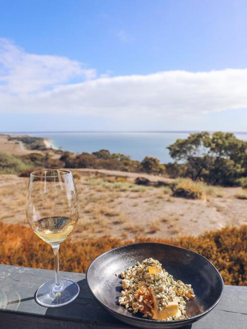 Lunch at Sunset Food and Wine, a clifftop oasis with spectacular views overlooking Eastern Cove...