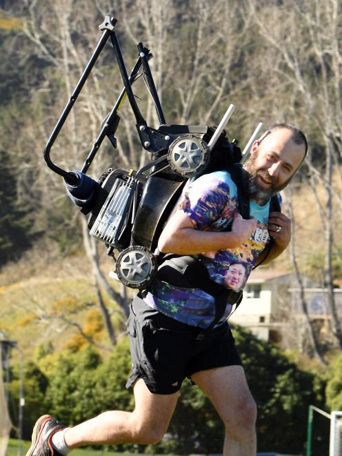 Andrew Glennie is preparing for the Northburn 100km Ultra race, when he will carry a lawnmower strapped to his back. Photo: Stephen Jaquiery