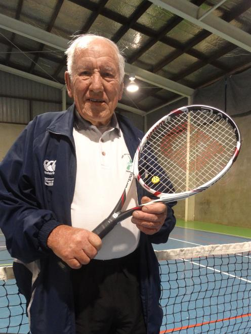 Terry Taylor is all set for another winter night's tennis. Photo: Chris Tobin