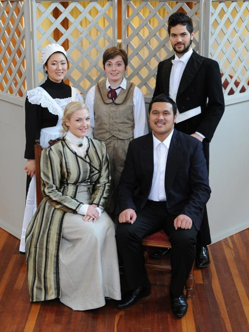Joel Amosa (front) with the Opera Otago 2012 cast of The Marriage of Figaro (front) Maia Vegar (Countess), back from left, Grace Park (Susanna), Helene Holman (Cherubims) and Kawiti Waetford (Figaro).