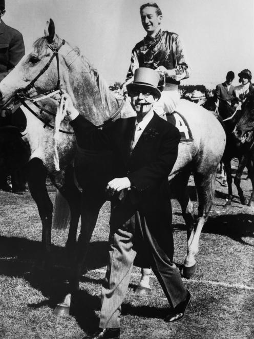 Racehorse owner E. C. S. Falconer leading his horse, Baghdad Note, ridden by jockey Midge Didham...