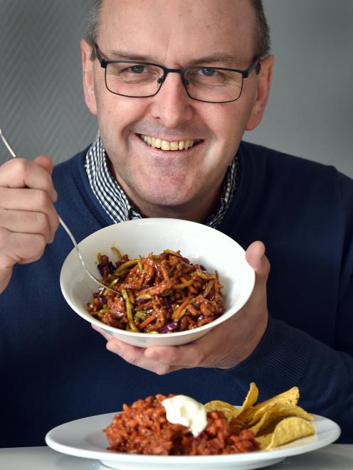 The Craft Meat Company co-owner Grant Howie with teriyaki stir-fry and chilli con carne dishes...