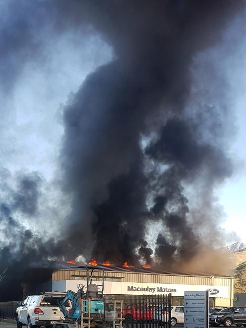 The Macaulay Motors dealership building in Queenstown on fire yesterday.