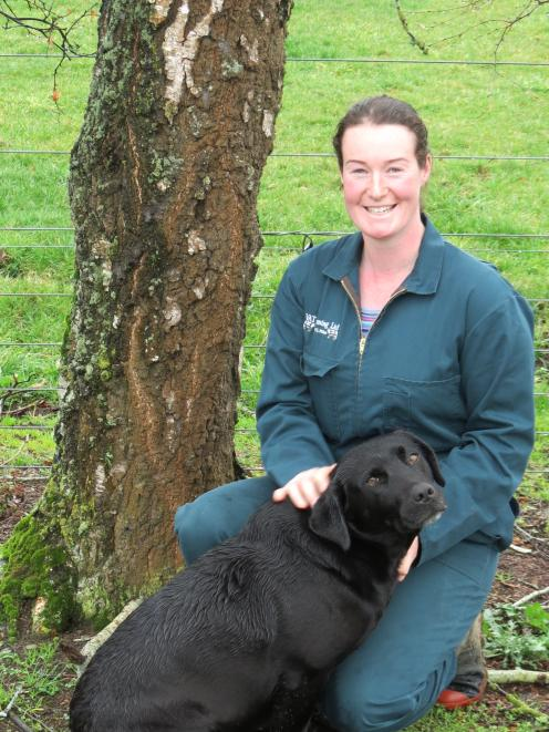 Farm manager Bridget Bell, of Avondale, pictured with Brax, was delighted when she placed second in this year's Southland Otago Dairy Industry Awards' farm manager of the year competition. She is the farm manager of a 327ha property, milking 1000 cows. Ph