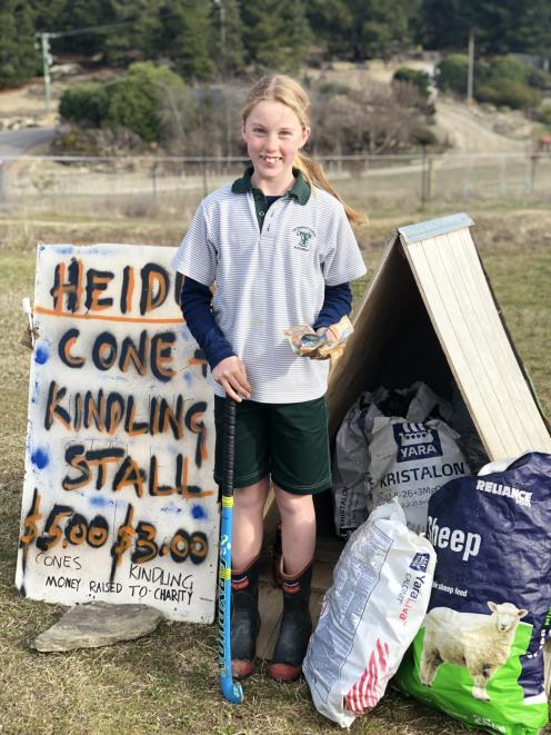 Terrace Primary School pupil Heidi Winter (10) shows off the fundraising stall that has contributed the first donation to the potential $2 million needed for the planned full-sized hockey turf in Alexandra. Photo: Supplied
