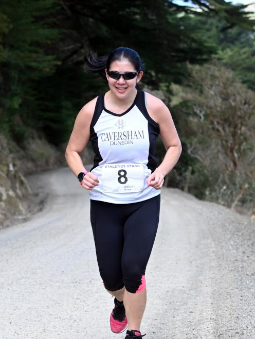 Cavy Dolphins team member Celia Lie contests the second leg of the Peninsula Relay on Saturday, involving a 3.2km climb up Hoopers Inlet and Sandymount roads to Highcliff. Lie recorded 25min 22sec to help set her team up for an eventual third place. Photo