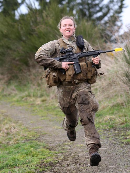Lance Corporal Kate Downie-Melrose, a Dunedin-based insurance industry manager, races between two...
