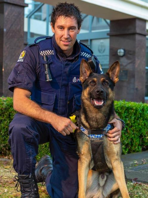 Constable Saunders and Police Dog Vann. Photo: Southern District Police Facebook
